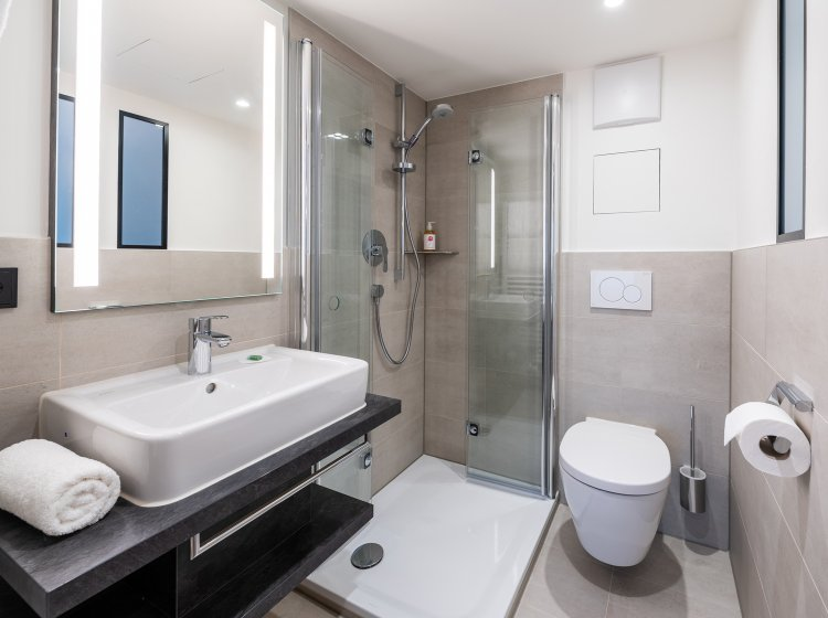 Hotelzimmer Besler – Badezimmer Biohotel Balderschwang